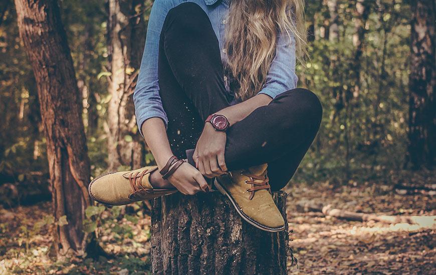 Woman-Sitting-On-Log