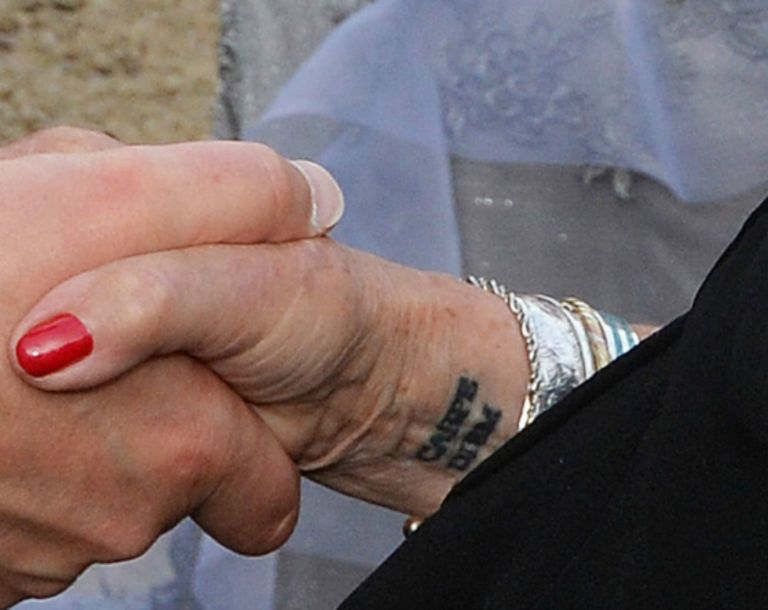 gallery-1467301780-judi-dench-carpe-diem-wrist-tattoo-2