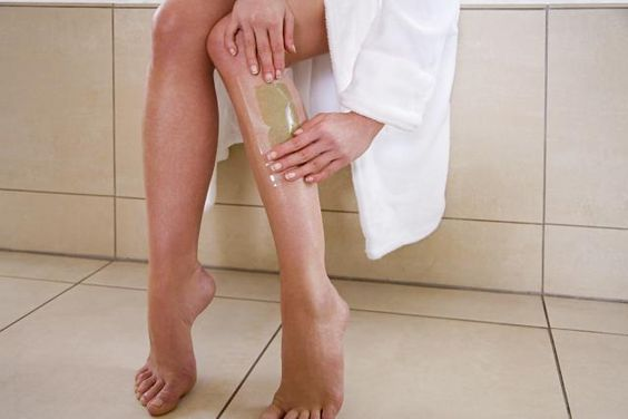 Woman waxing leg