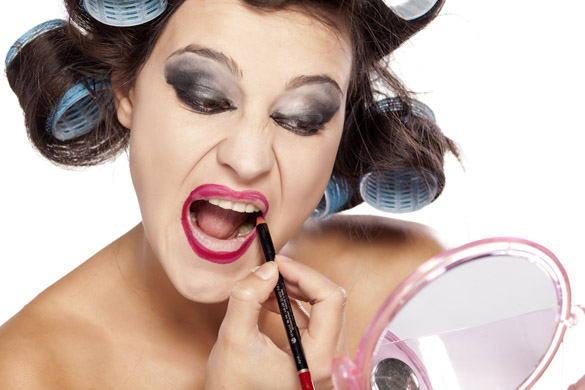 funny-woman-with-curlers-and-bad-makeup-applied-lip-pencil